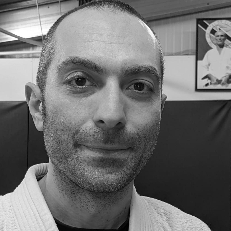 Massimo Caprara, Bullyproof & Combatives Instructor (Certified), Gracie Jiu-Jitsu Blue Belt